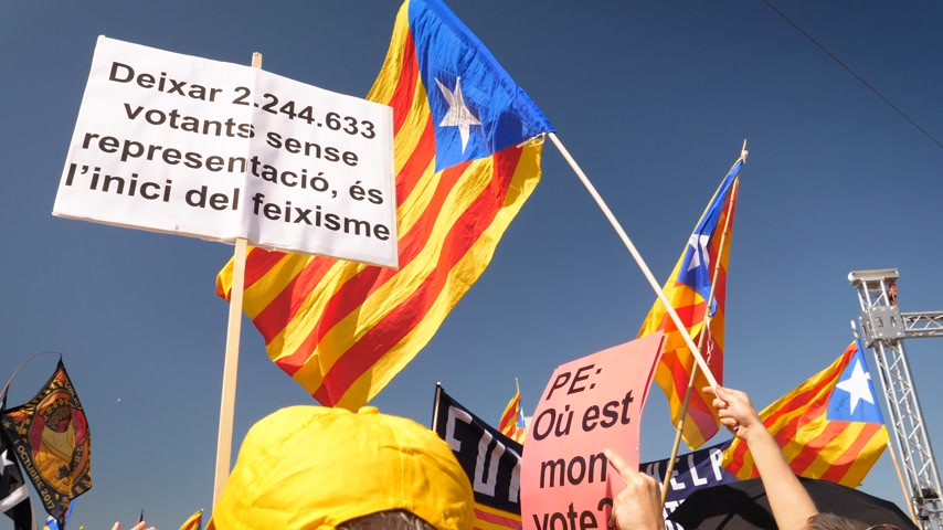 protestor : Strasbourg, France - Jul 2 2019: People holding immense Estelada Catalan separatist flags demonstration protest front of EU European Parliament against exclusion of three Catalan elected MEPs