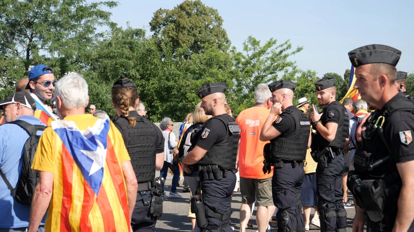 squadron : Strasbourg, France - Jul 2 2019: Rear view of group of gendarmerie Police guiding protesters with Catalan separatist flags demonstrate protest front of EU European Parliament slow motion