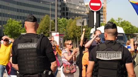 protestor : Strasbourg, France - Jul 2 2019: Rear view of two gendarmerie Police guiding protesters with Catalan separatist flags demonstrate protest front of EU European Parliament Stock Footage
