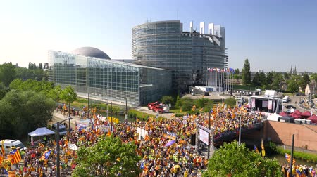 espana : Strasbourg, France - Jul 2 2019: Aerial view over thousands of people demonstrating at protest front of EU European Parliament against exclusion of three Catalan elected MEPs still drone view