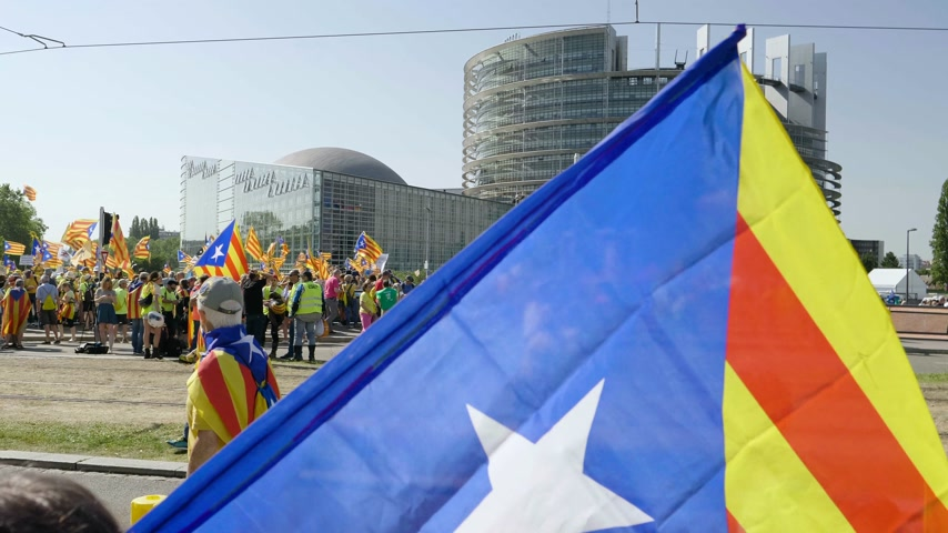protestor : Strasbourg, France - Jul 2 2019: People holding Catalan flags and placards at demonstration protest front of EU European Parliament against exclusion of three Catalan elected MEPs