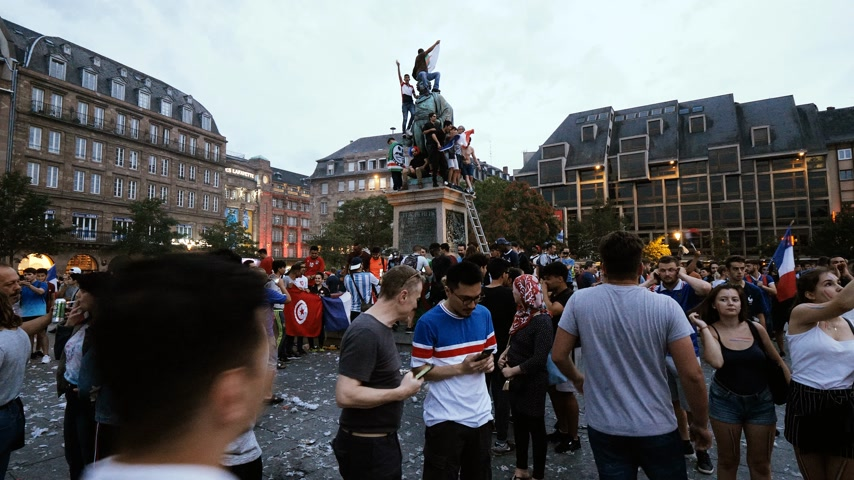 french team : STRASBOURG, FRANCE - JULY 15, 2018: Algerian French Flag waving Statue Happiness and jubilation of supporters after the victory of the French team in the final of the World Cup football in Russia Stock Footage