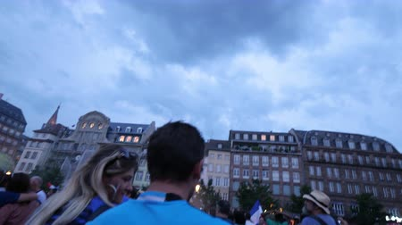 first person : STRASBOURG, FRANCE - JULY 15, 2018: Fireworks Place Kleber Happiness and jubilation of supporters after the victory of the French team in the final of the World Cup football in Russia against Croatia Stock Footage