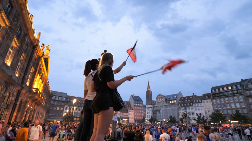 french team : STRASBOURG, FRANCE - JULY 15, 2018: Happiness and jubilation of supporters girls with flag after the victory of the French team in the final of the World Cup football in Russia against Croatia