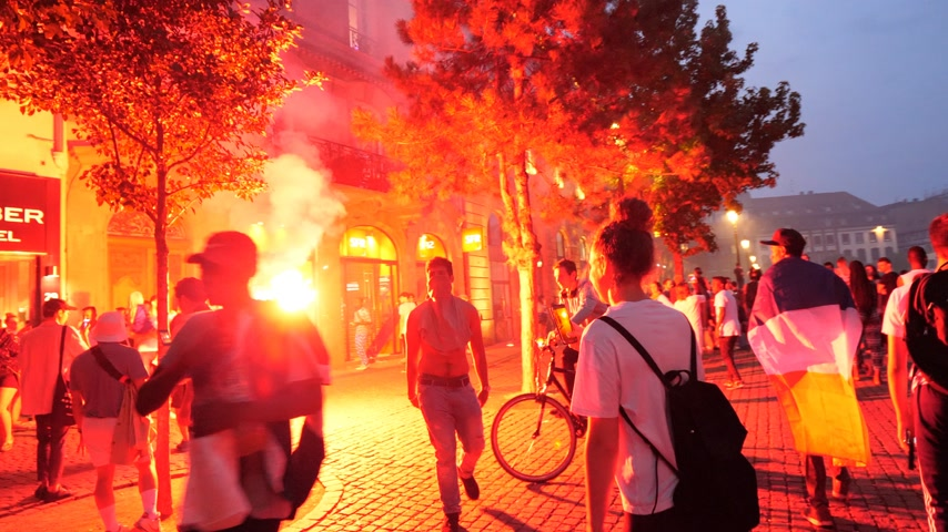 french team : STRASBOURG, FRANCE - JULY 15, 2018: Happiness and jubilation of supporters after the victory of the French team in the final of the World Cup football in Russia - fire in Place Kleber