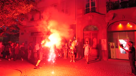 french team : STRASBOURG, FRANCE - JULY 15, 2018: Flare grenade with happiness and jubilation of supporters after the victory of the French team in the final of the World Cup football in Russia against Croatia