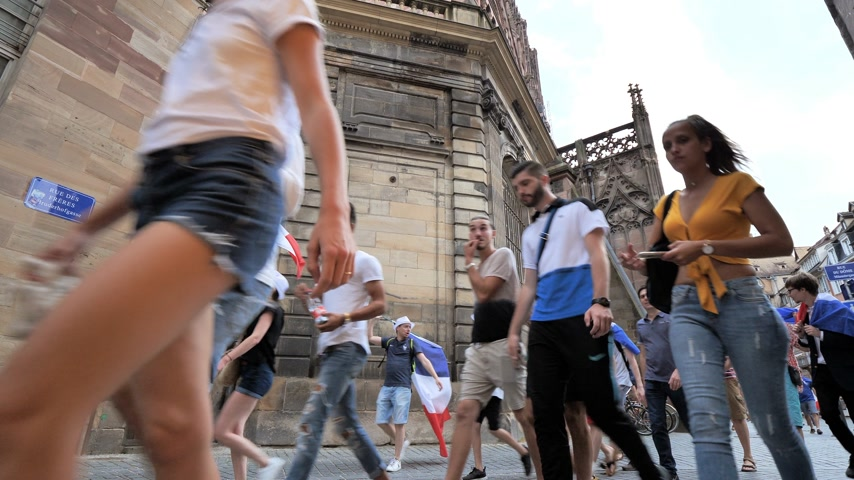 french team : STRASBOURG, FRANCE - JULY 15, 2018: Pedestrians singing after the victory of the French team in the final of the World Cup football in Russia against Croatia