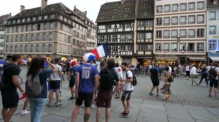 french team : STRASBOURG, FRANCE - JULY 15, 2018: Supporters celebrating gathering in city center after the victory of the French team in the final of the World Cup football in Russia against Croatia