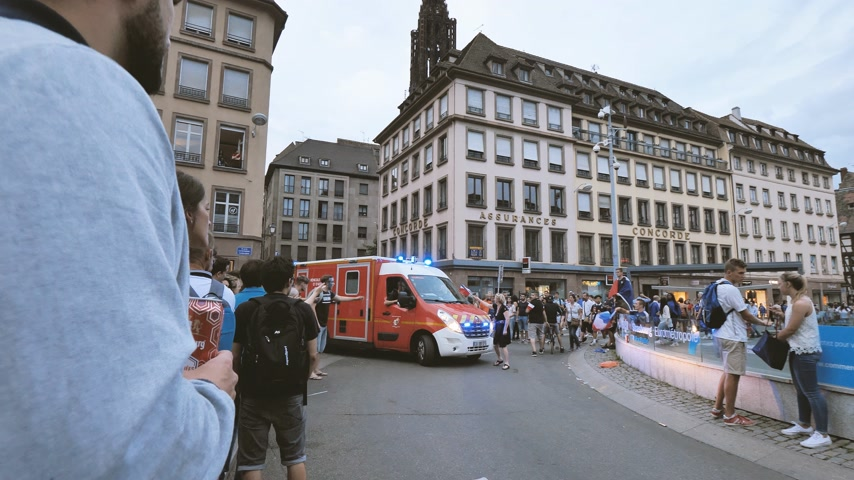 karetka : STRASBOURG, FRANCE - JULY 15, 2018: Ambulance between crowd of supporters after the victory of the French team in the final of the World Cup football in Russia against Croatia