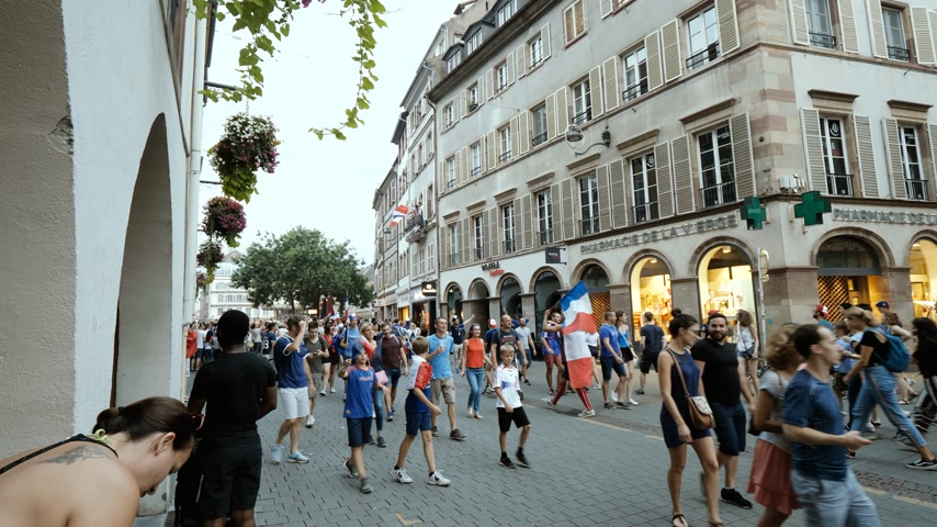 trofej : STRASBOURG, FRANCE - JULY 15, 2018: Thousands of people marched through the streets of the city to express their joy after the victory of the France team against Croatia