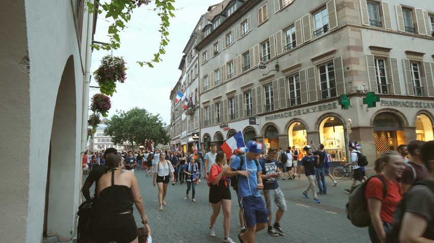 french team : STRASBOURG, FRANCE - JULY 15, 2018: Walking happy supporters after the victory of the French team in the final of the World Cup football in Russia against Croatia