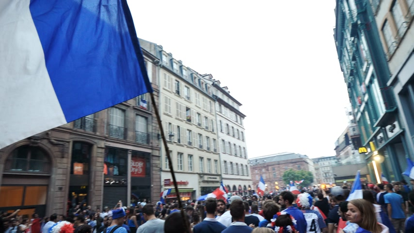french team : STRASBOURG, FRANCE - JULY 15, 2018: Thousands of people marching through the streets to express their joy after the victory of the France team against Croatia Stock Footage