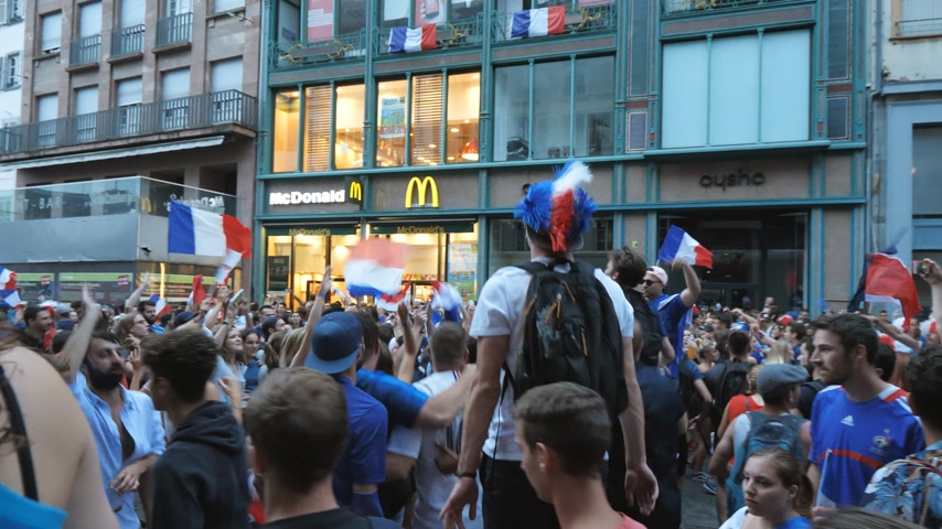 mcdonalds : STRASBOURG, FRANCE - JULY 15, 2018: Happiness and jubilation of jumping supporters after the victory of the French team in the final of the World Cup football in Russia against Croatia Stock Footage