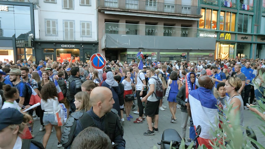first officer : STRASBOURG, FRANCE - JULY 15, 2018: the jubilation of supporters after the victory of the French team in the final of the World Cup football in Russia against Croatia