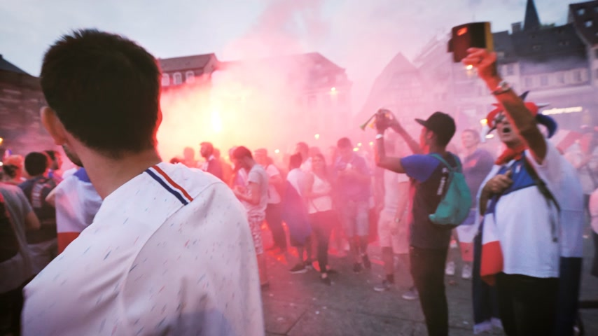 french team : STRASBOURG, FRANCE - JULY 15, 2018: Happiness and jubilation of supporters with distress flare s and smoke grenades after the victory of the French team in the final of the World Cup football