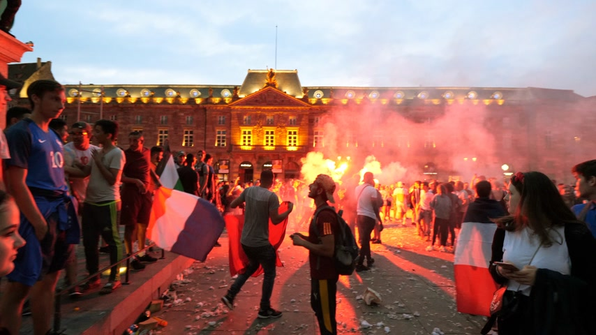 french team : STRASBOURG, FRANCE - JULY 15, 2018: Smoke grenade as happiness and jubilation of supporters after the victory of the French team  in Russia against Croatia