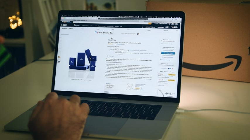 amazon prime : PARIS, FRANCE - JUL 16 2019: Man POV looking at Amazon Netherlands Prime Day shopping deals on Apple MacBook Pro laptop with Safari Internet browser open special discounts gifts Swarovski diamonds jewelry