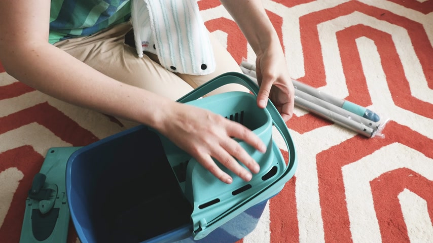 amazon prime : Paris, France - Circa 2018: Overhead view of woman assembling new Leifheit Set Combi Disc Mop includes Combi Disc Mop, Press and Combi Bucket with 3-part handle