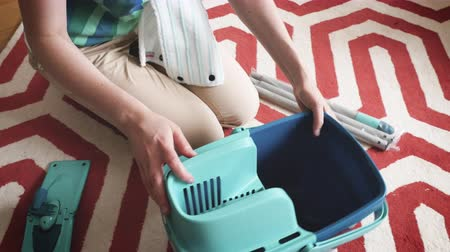 manipular : Paris, France - Circa 2018: Housewife woman assembling new Leifheit Set Combi Disc Mop includes Combi Disc Mop, Press and Combi Bucket with 3-part handle