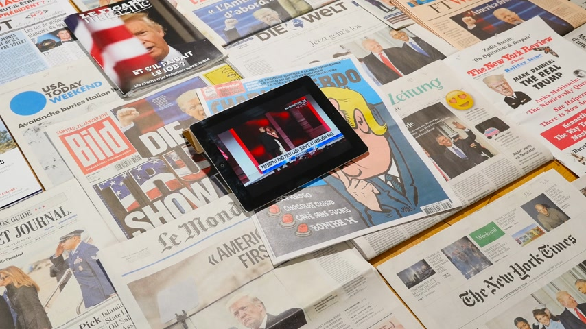 caricatura : Paris, France - Jan 2017: multiple international newspaper featuring the election of Donald Trump as a president of United States - iPad running his and First lady dance at freedom ball - time lapse