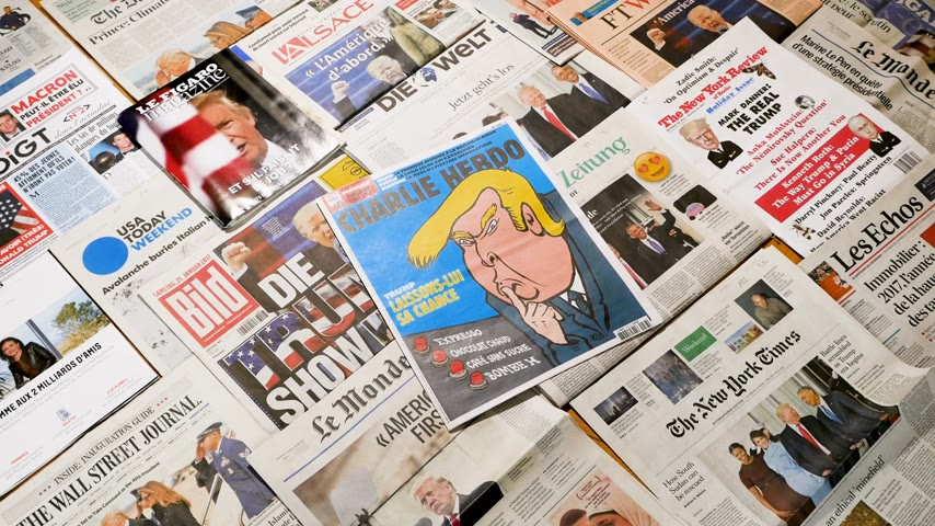 front cover : Paris, France - Jan 2017: Panning view from above over multiple international newspaper featuring the election of Donald Trump as a president of united states