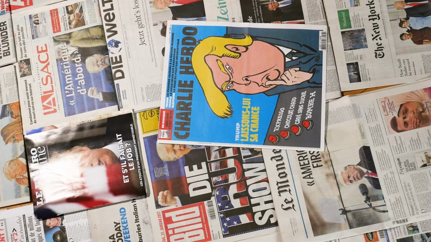 front cover : Paris, France - Jan 2017: Rotation view from above over multiple international newspaper featuring the election of Donald Trump as a president of united states