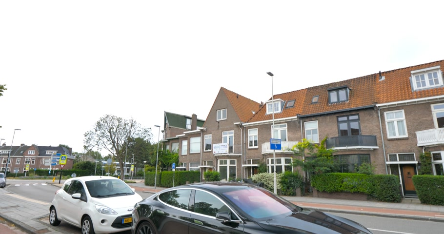 tesla model s : Haarlem, Netherlands - Aug 16, 2018: Black electric new Tesla P85 car parked on the street in Dutch city with traditional architecture buildings in background