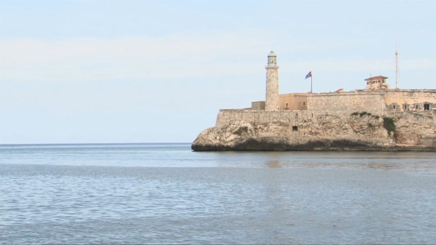 kübalı : Morro Castle view on a perfect weather day with little cuban flag