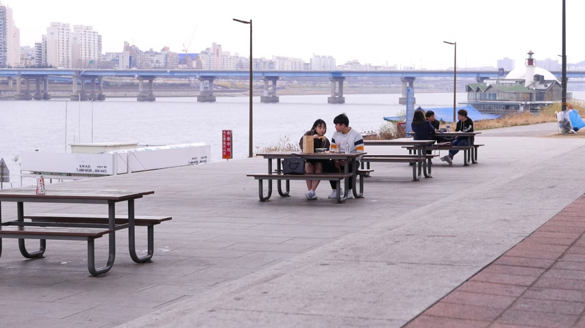 han river : Young couple korean students have lunch at park, eating together outside, Seoul, South Korea