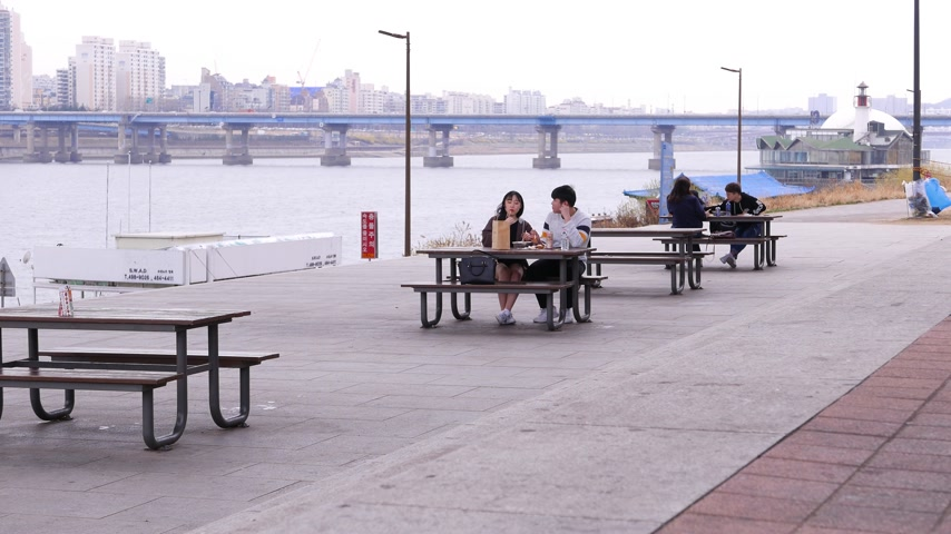 south asian food : Romantic korean couple at Han river, eating together at park, Seoul, South Korea