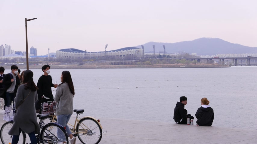 han river : Group of young students walk together along Han river, Seoul, South Korea
