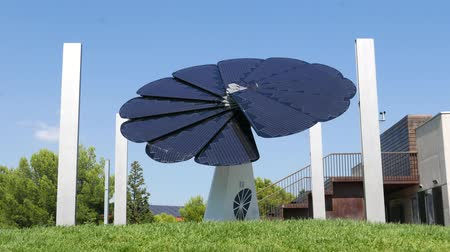 photovoltaic : Solar panel in shape of big flower follow sun Stock Footage