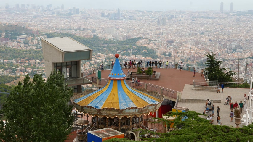 Tibidabo Amusement Park, tourists on viewing point and Barcelona Stok Video