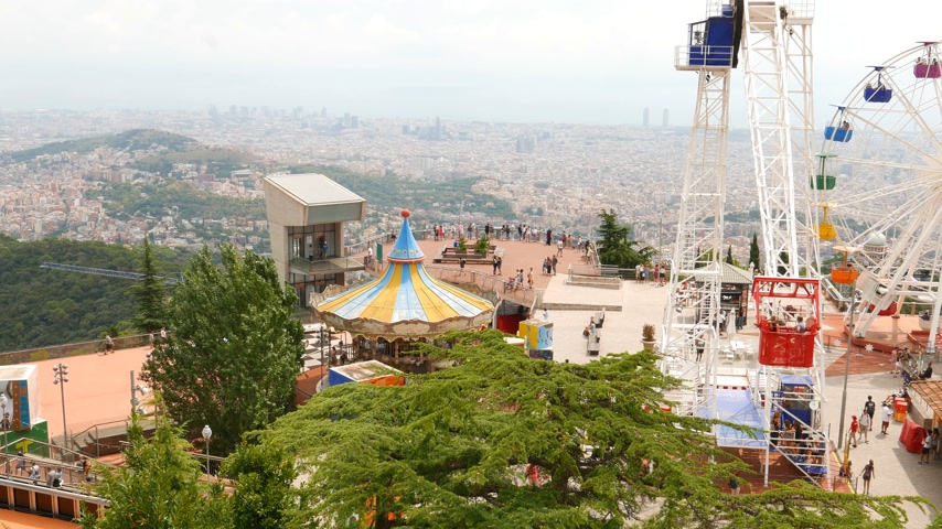 observation deck : Tibidabo Amusement Park, tourists on viewing point and Barcelona Stock Footage