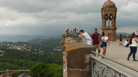 bell tower : Tourists on Tibidabo viewing point, Barcelona, Spain