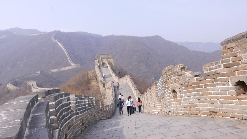 Man take stairs on Great Wall of China