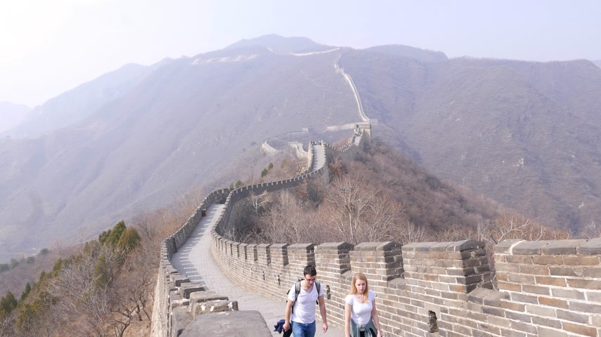 Romantic couple walk on Great Wall of China