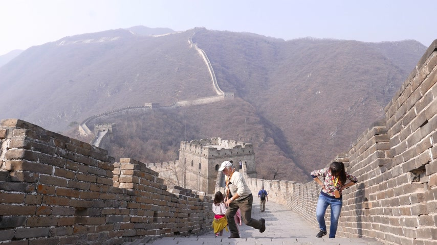 Tourists walk upstairs on Great Wall of China