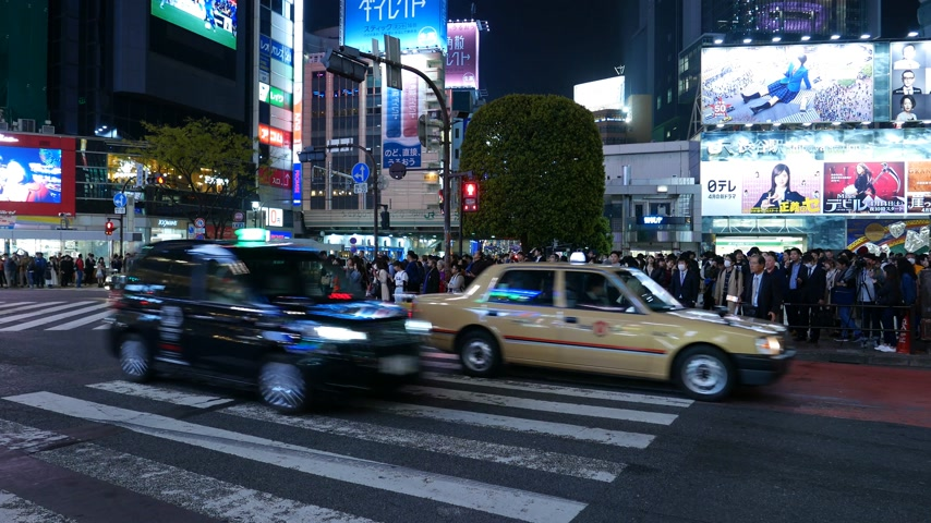 Car traffic at Shibuya crosswalk at night, Tokyo, Japan