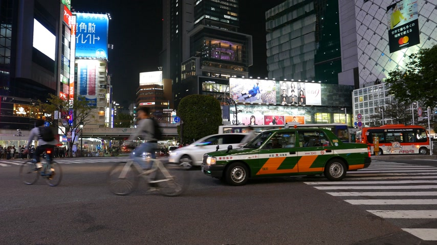 Busy road traffic on Shibuya crosswalk, Tokyo, Japan Stock Footage