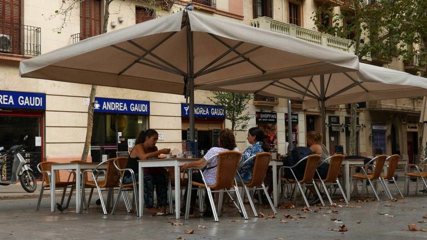 Hispanic women in street cafe, Barcelona
