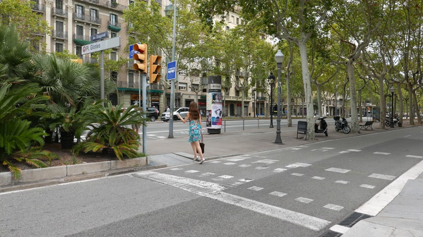 Woman run on pedestrian crossing at Avenue Diagonal, Barcelona