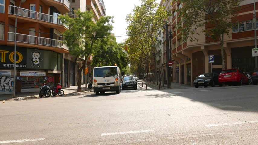 Car turning at crossroad at hot sunny day, Barcelona