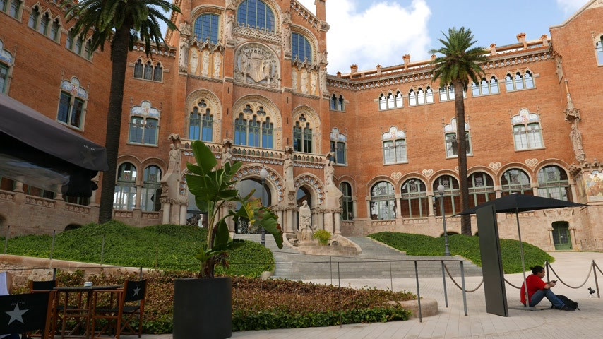 Tourist man relax at Hospital de Sant Pau court, Barcelona