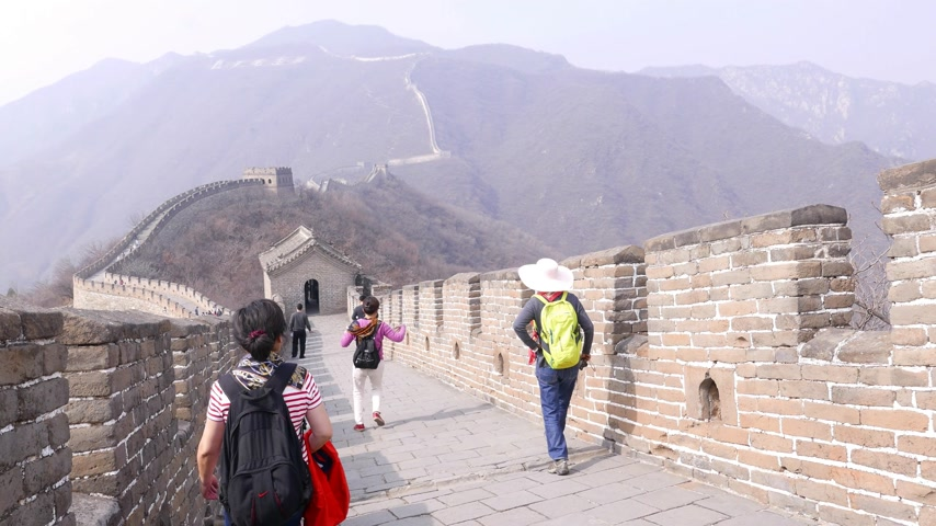 Asian woman make photos on Great Wall of China