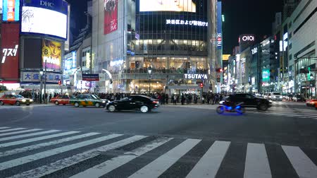 Cars driving on famous Shibuya pedestrian scramble, Tokyo