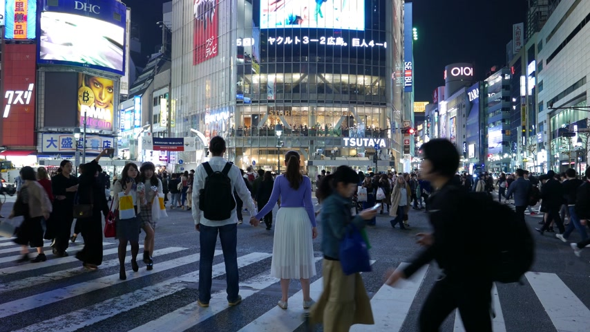 People posing and make photos at Shibuya pedestrian scramble, Tokyo Stock Footage