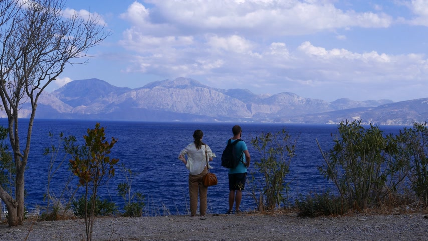 Tourists on mountain top enjoy sea and mountains view, Crete, Agios Nikolaos