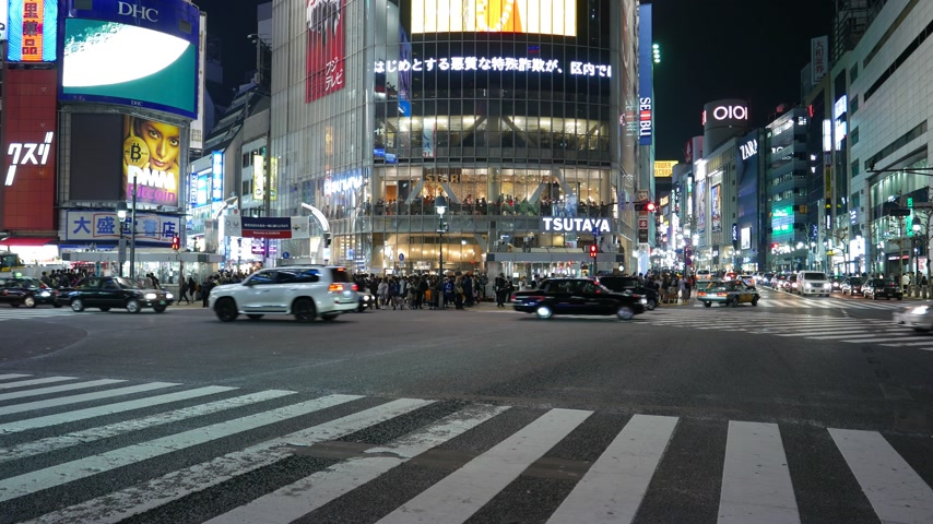 Road traffic at Shibuya crossing at night, Tokyo, Japan Stock Footage