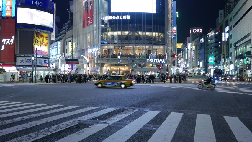 Driving cars at famous Shibuya crossing at night, Tokyo, Japan